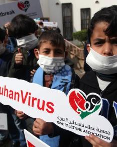 أطفال غزة يتضامنون مع نظرائهم الصينيين بسبب كورونا