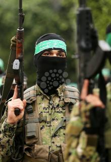 عرض للقسام بخان يونس بذكرى انطلاقة حماس الـ30