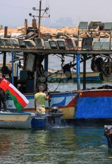 ناشطون بغزة يتضامنون مع العالم بمواجهة كورونا